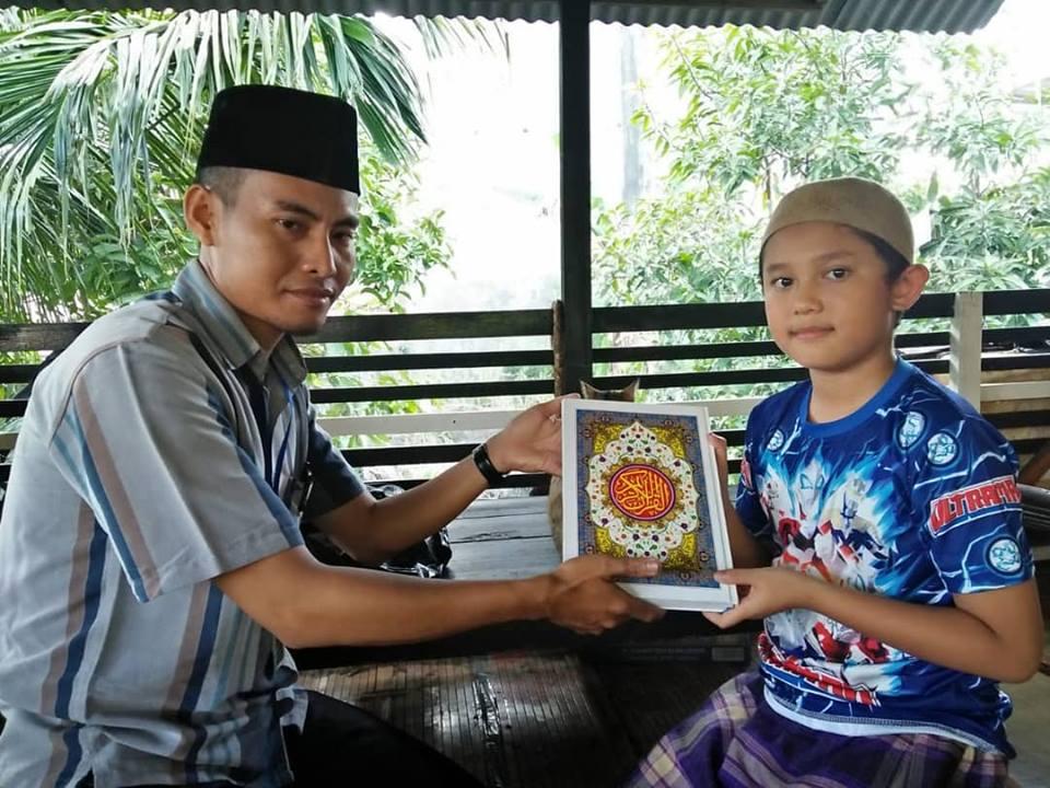 mengajarkan baca al-quran